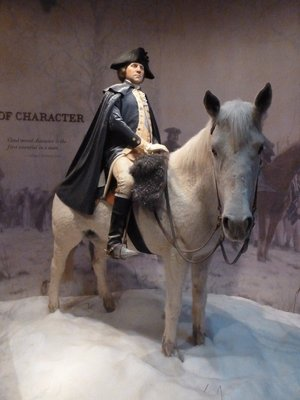 Model of George Washington (45 years old) leading his army at Valley Forge (1777-1778)