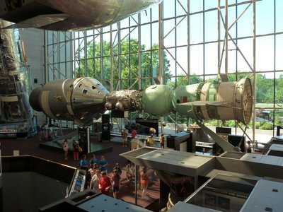 Apollo-Soyuz Test Project (1975) with the Hubble Space Telescope (1990) in the corner