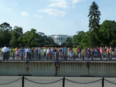 Crowds by the railings in front of the White House