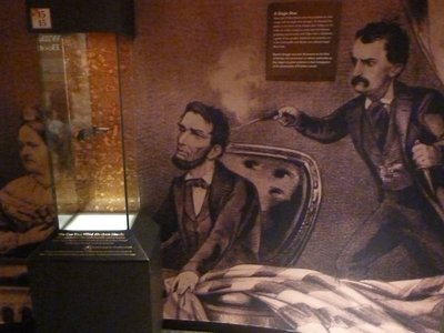 Glass case containing the gun that killed Abraham Lincoln
