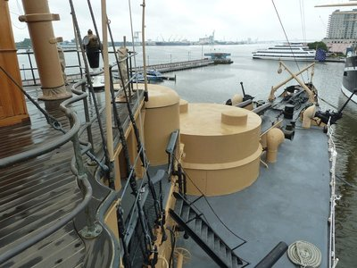 The forward deck and 8 inch gun turret of the USS Olympia