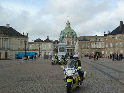 Police outriders were setting off at regular intervals when I arrived at the Amalienborg Palace