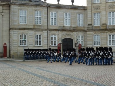 The midday Changing of the Guard Ceremony outside the Amalienborg Palace