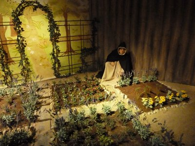 Monk attending his crops in the Medieval Museum of Stockholm