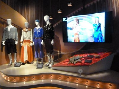 ABBA's costumes and their original Eurovision performance on endless loop on screen at the ABBA Museum