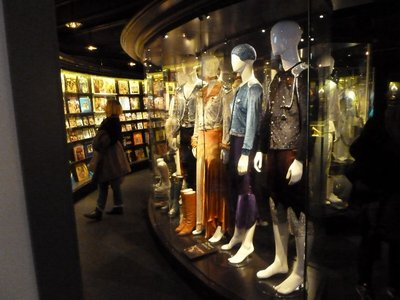 Inside the ABBA Museum Gold Room filled with their stage costumes and gold discs