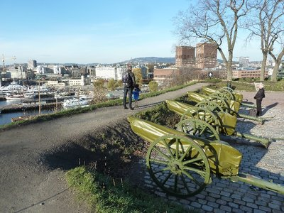 Guns on the battlements of Akerhus Festning overlooking Oslofjord and Oslo Town Hall