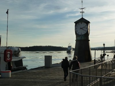 Harbour Clock on the shores of Oslofjord as the Nessodden Ferry comes in
