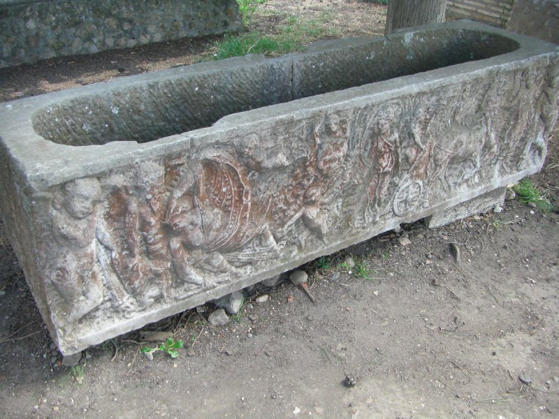 A carved stone sarcophagus