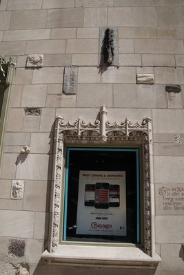 The Tribune Building has small pieces of. Famous buildings set into the blockwork