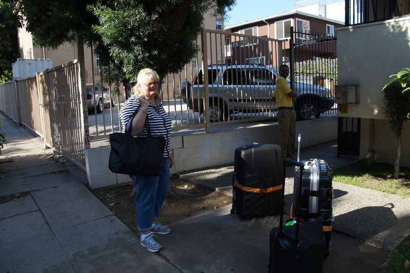 Colleen with the luggages outside our LA apartment