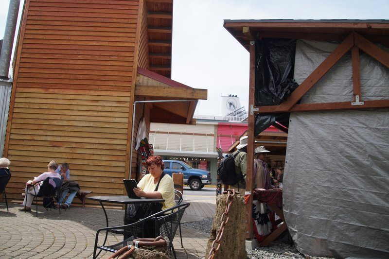 View from coffee shop showing Sharon on the computer, street behind and funnel of Volendam