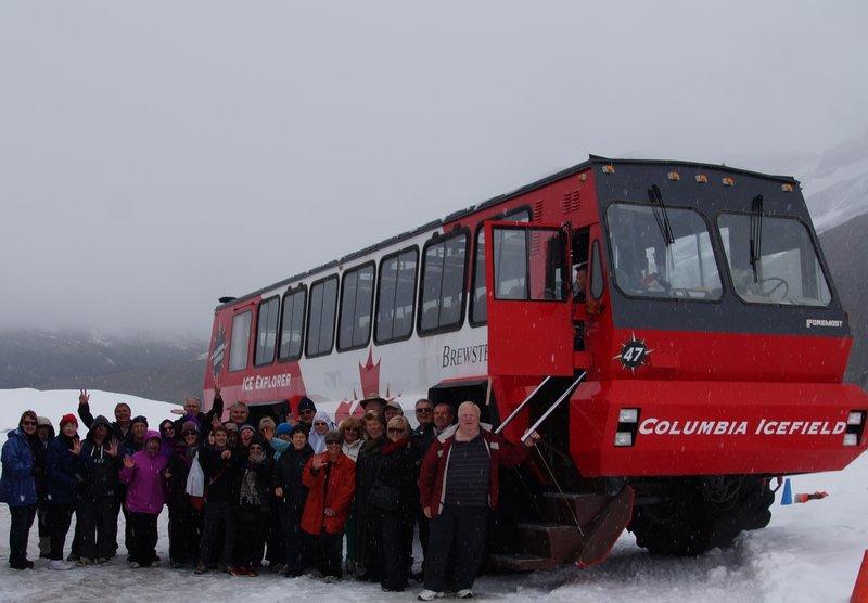 Group Photo beside Ice Explorer on Athabascar Glacier