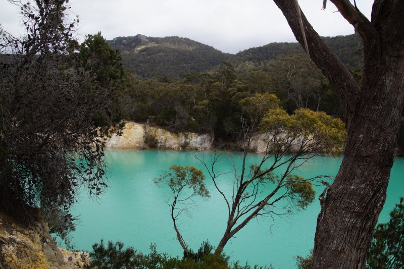 Little Blue Lake near  South Mt Cameron - clay deposits left after tin mining reflect sunlight and make the water appear turquoise blue