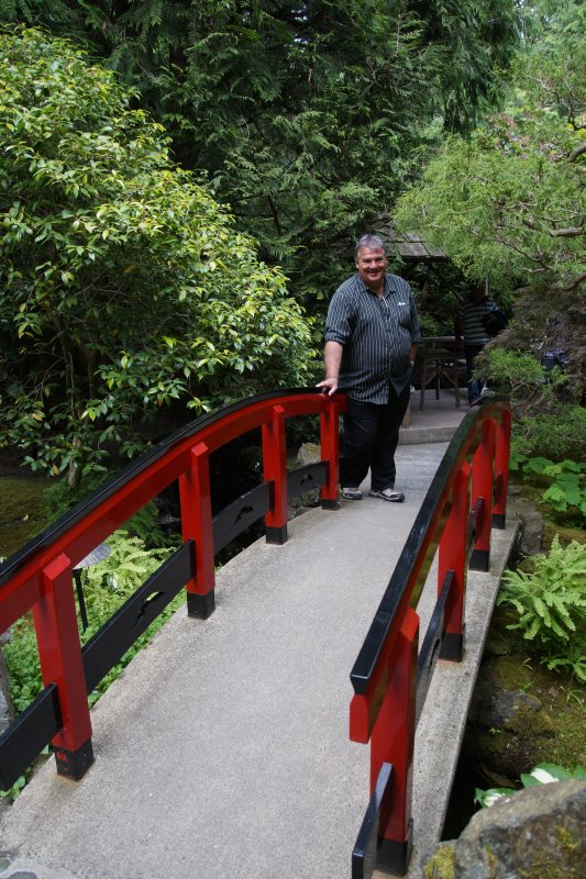 Richard on the bridge at  The Japanese Garden at  The Butchart Gardens