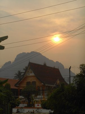 Sunset over the temple. Van Vieng