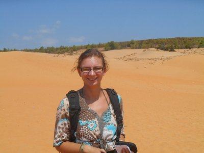 Posing in the red sand dunes
