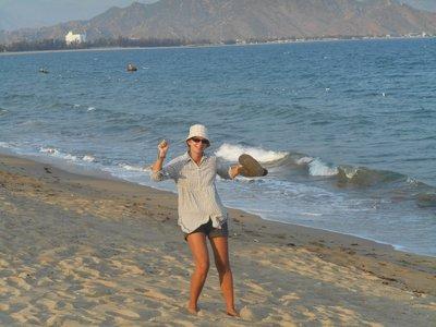 Joanna dancing on the beach