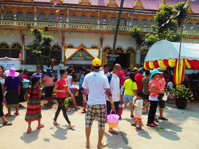 As per tradition, Buddhas are taken out on the Lao new year and they are cleaned by people