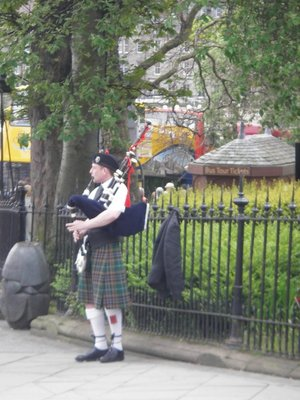 A piper busking for the tourists