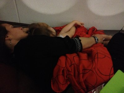 Asleep, lying down, in an airplane.  Pretty cush.