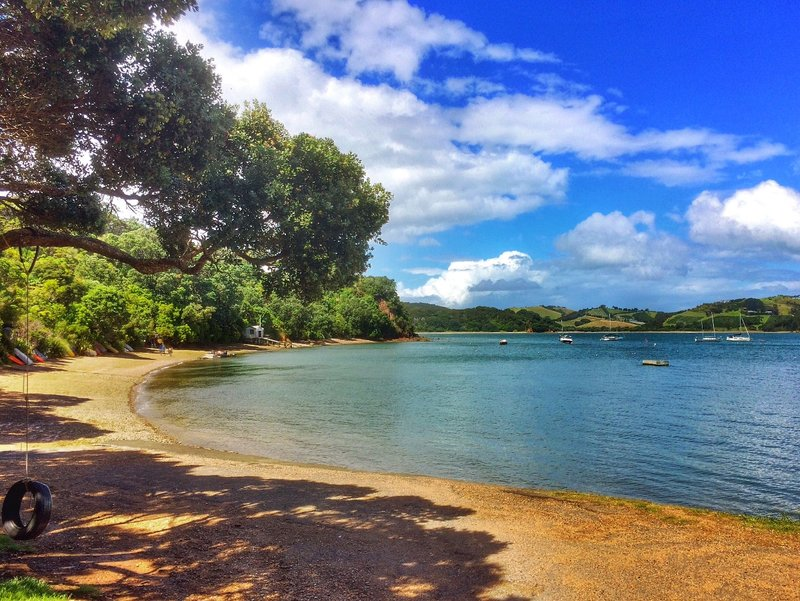 Relaxing and skipping rocks at Rocky Bay, Waiheke Island