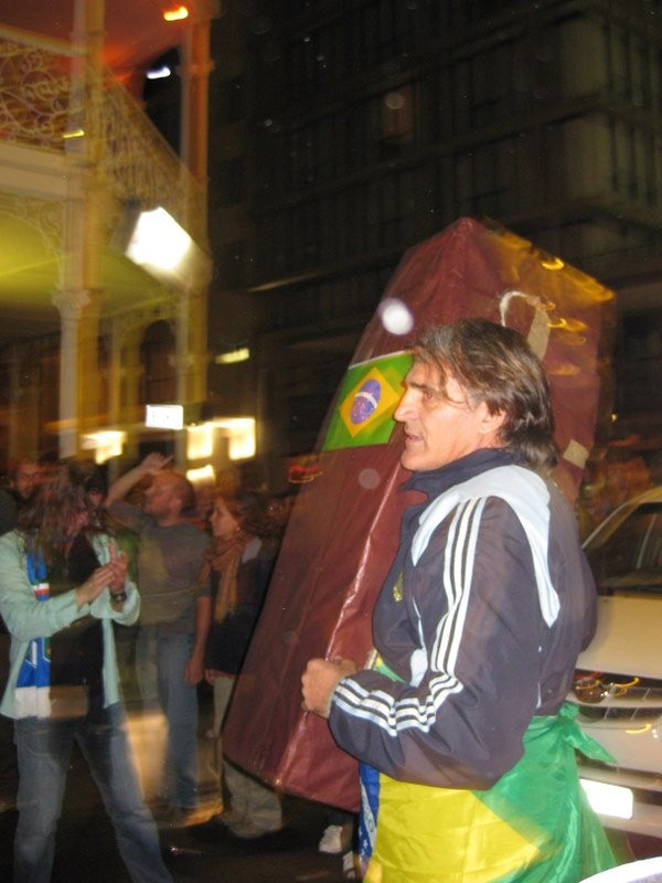Argentinians celebrating the demise of Brazil in the streets of Cape Town. The Netherlands had won 2-1 about 4 hours beforehand and this guy had already produced a coffin. 1 day later he would be able to put his own flag on the box