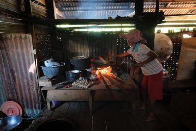 Roasting coffee in the kitchen of the Tongkonan, traditional home