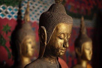 Detail, standing Buddha image, Wat Xieng Thong monastery, Luang Prabang
