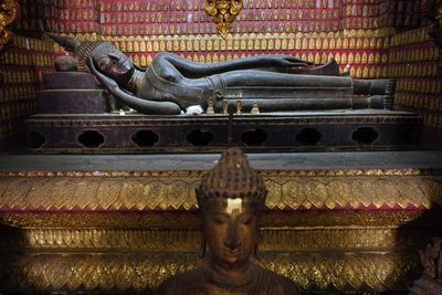 Reclining Buddha in the red chapel at Wat Xieng Thong monastery, Luang Prabang