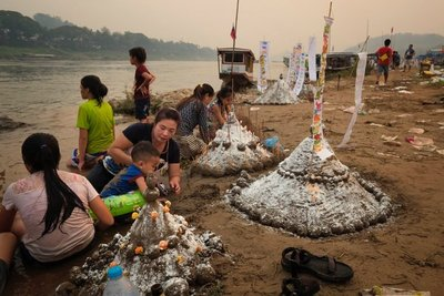 Making sand stupas in Luang Prabang