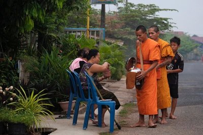 Monks receiving alms, Champasak