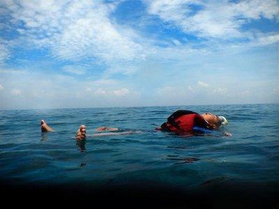 Little boy floating, Perhentian Islands