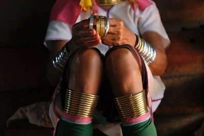 Long neck woman with rings on arms and legs, Kayah State