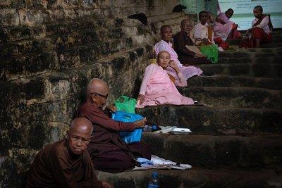Monks in front of Paya Shittaung temple, Mrauk-U
