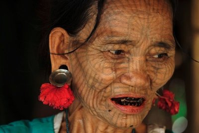 Ethnic Chin lady with facial tattoo