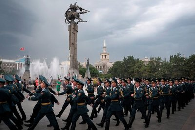 Police cadets by statue of (hero) Manas, in front of Bishkek Philharmonic