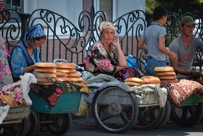 Lady selling bread from a converted baby carriage, Samarkand, UZ