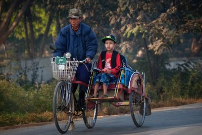 Man and boy with bicycle rickshaw, Nyaungshwe