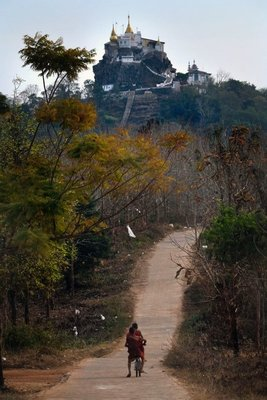 Two monks on a bicycle near a hill Temple, Loikaw