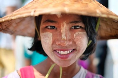 Girl with Thanaka designs on her cheeks