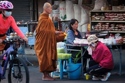 Offering food and respect to a monk, Chiang Mai, Thailand