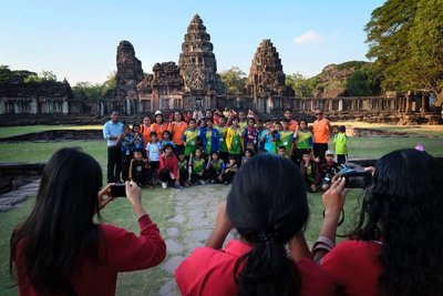 School kids visiting Khmer temple, Phimai, Thailand