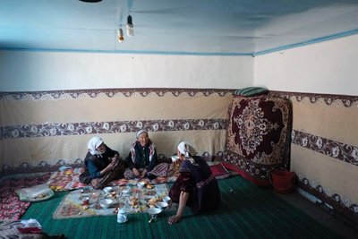 Day 3: Ladies sharing a meal in Karakul
