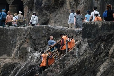 Ajanta cave temples - some visitors opt to be carried