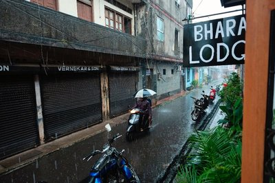 Trying to stay dry on a bike in Panjim