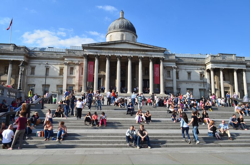 Tourists line steps on trafalgar square.