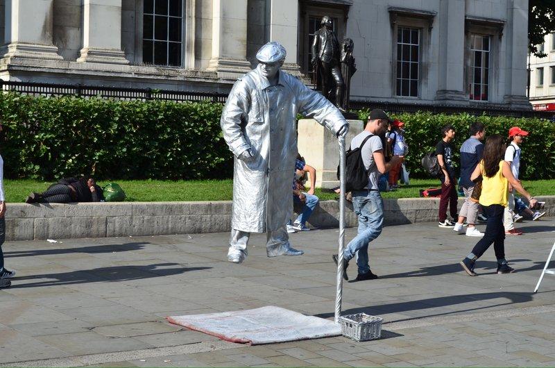 Trafalgar square street artist.