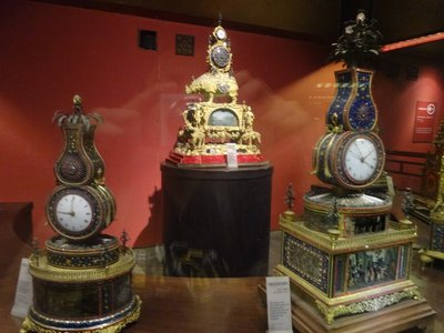 A section of clocks on display