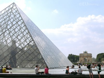 Louvre Pyramid with the arch in the background